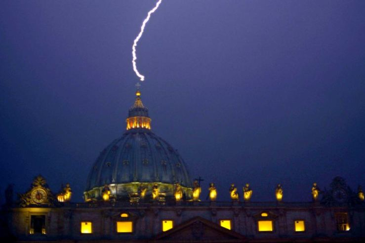 The dome of St. Peters strick by lightning on the night of the Papal resignation